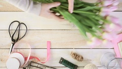 Time-lapse. Step by step. Florist wrapping pink tulips in bouquet. Stock Footage