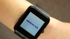 Using A Smart Watch Device. The Best Airlines in the World Stock Footage