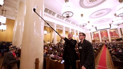 Two young guys take selfie with smartphone and extendable monopod in MGU Stock Footage
