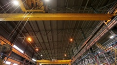 Crane moving steel bars to the storage, wide shot Stock Footage