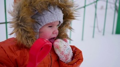 Happy child having fun playing in the park on a sunny winter day. Snow winter Stock Footage