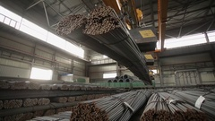 Industrial magnet placing steel bars inside the warehouse medium shot Stock Footage