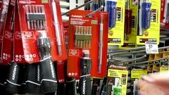 Motion of woman buying screwdriver set at Home Depot store Stock Footage
