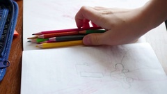 A child draws with colored pencils. 4 video in 1 Stock Footage