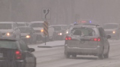 Traffic jam and gridlock in the city streets during snow storm Stock Footage