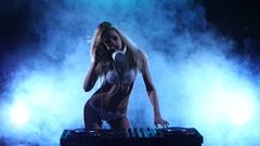 Sexy DJ girl in white lingerie with sparkles. Smoke studio Stock Footage