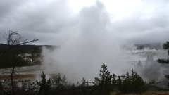 Zooming timelapse of a field full of smoking geysers, at norris geyser basi.. Stock Footage