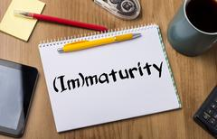 (Im)maturity - Note Pad With Text Stock Photos