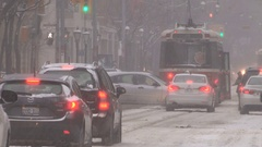 Downtown Toronto cars buses and streetcars in snow storm on cold winter day Stock Footage