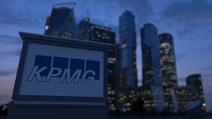 Street signage board with KPMG logo in the evening.  Blurred business distric Stock Footage