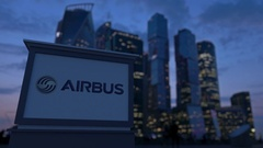 Street signage board with Airbus logo in the evening.  Blurred business distric Stock Footage