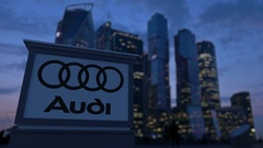 Street signage board with Audi logo in the evening.  Blurred business distric Stock Footage
