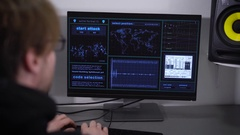 Back view of professinal hacker making cyber attack on network of the Bank. Spy Stock Footage