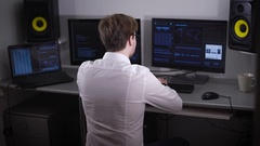 Office worker, like a security company manager sits at his workplace. He turned Stock Footage