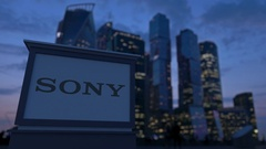 Street signage board with Sony Corporation logo in the evening.  Blurred busines Stock Footage