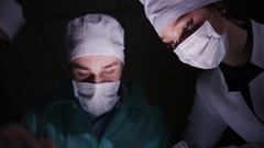 Doctors surgeons operate patient in operating theater. Surgical team performing Stock Footage