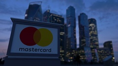 Street signage board with MasterCard logo in the evening.  Blurred busines Stock Footage