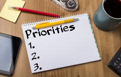 Priorities 1. 2. 3. - Note Pad With Text On Wooden Table Stock Photos