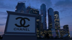 Street signage board with Chanel logo in the evening.  Blurred business distric Stock Footage