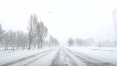 Driving POV on snowy road. Snow storm driving urban street fast . Winter sn.. Stock Footage