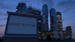 Street signage board with Louis Vuitton logo in the evening.  Blurred busines Stock Footage