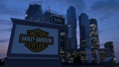 Street signage board with Harley-Davidson, Inc. logo in the evening.  Blurre Stock Footage