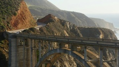 Zooming out timelapse of cars driving on Bixby Creek Bridge, in Big sur, Ca.. Stock Footage