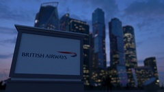 Street signage board with British Airways logo in the evening.  Blurred busines Stock Footage