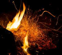 Fire with sparks on a black background Stock Photos