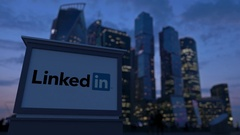 Street signage board with LinkedIn logo in the evening.  Blurred busines Stock Footage