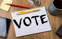 VOTE - Note Pad With Text On Wooden Table Stock Photos