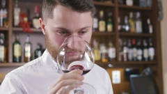 Sommelier tating the wine, slow motion Stock Footage