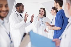 Outgoing doctors telling during pause in hospital Stock Photos