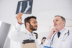 Serene therapeutics arguing about radiograph in clinic Stock Photos