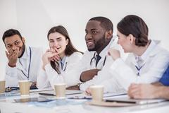 Cheerful therapeutics telling during meeting in office Stock Photos