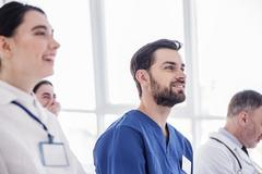 Smiling doctor looking discourse in hospital room Stock Photos