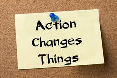 Action Changes Things ACT - adhesive label pinned on bulletin board Stock Photos
