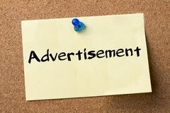 Advertisement - adhesive label pinned on bulletin board Stock Photos