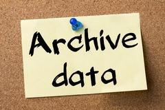 Archive data - adhesive label pinned on bulletin board Stock Photos