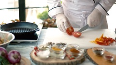 Chef cutting tomato. Stock Footage