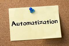 Automatization - adhesive label pinned on bulletin board Stock Photos