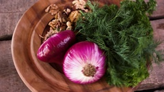 Purple onions on wooden background. Stock Footage