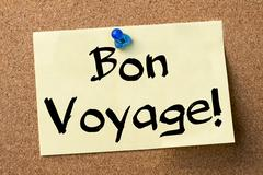 Bon Voyage! - adhesive label pinned on bulletin board Stock Photos