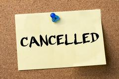 CANCELLED - adhesive label pinned on bulletin board Stock Photos