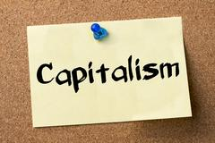 Capitalism - adhesive label pinned on bulletin board Stock Photos