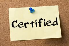 Certified - adhesive label pinned on bulletin board Stock Photos