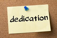 Dedication - adhesive label pinned on bulletin board Stock Photos