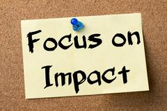 Focus on Impact - adhesive label pinned on bulletin board Stock Photos