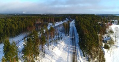 Cinema 4k aerial tilt view of a car driving on a snowy road, on a sunny win.. Stock Footage
