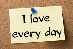 I love every day - adhesive label pinned on bulletin board Stock Photos